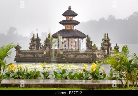 Ulun Danu Temple in monsoon season, Beretan Lake, Bali, Indonesia - Stock Photo