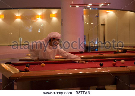 dubai UAE mall of the emirates,kids, in a traditional dress plays bowling - Stock Photo
