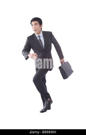 Young businessman holding briefcase running portrait - Stock Photo