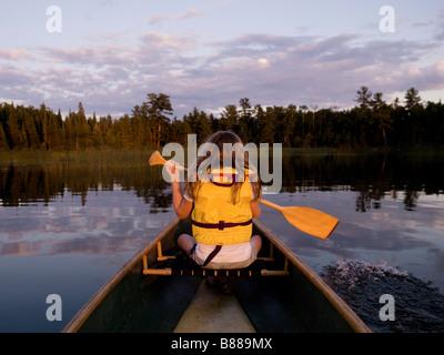 Girl in canoe - Stock Photo