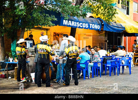 Mariachi band at sidewalk cafe in old town Mazatlan Sinaloa Mexico - Stock Photo