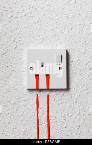 Bleeding UK mains electricity plug socket - Stock Photo