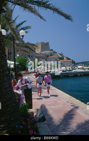 Bunifaziu Old town Port Harbour Boats moored Quayside Cafes shops People Couple holding hands BONIFACIO CORSICA - Stock Photo