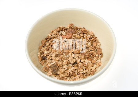 Granola Cereal rolled oats with dried fruits and nuts in a bowl on white background - Stock Photo