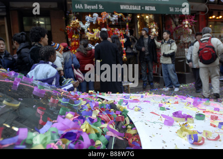 Confetti from artificial fireworks litters the streets Chinatown during the annual Chinatown Lunar New Year Parade - Stock Photo
