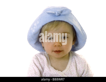 Toddler wearing a blue sun hat - Stock Photo