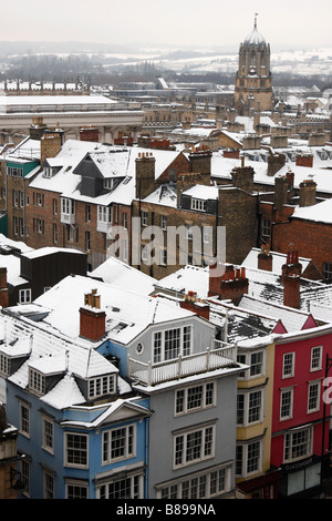 View of Oxford City from [University Church of St Mary the Virgin] rooftops covered in winter snow, High Street, - Stock Photo