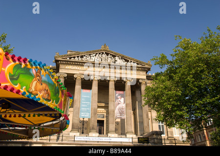 Harris Museum and Art Gallery with a fun fair outside in Preston Lancashire United Kingdom - Stock Photo