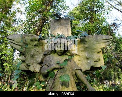 Stone angel in Highgate cemetery - Stock Photo