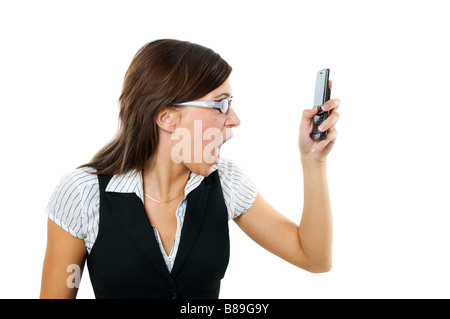 Angry businesswoman shouting to a mobile Isolated on white - Stock Photo