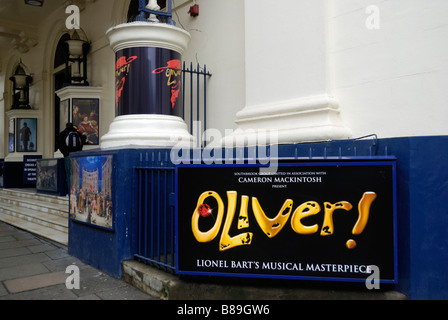 Billboards advertising the stage musical Oliver outside the Theatre Royal Drury Lane Covent Garden London - Stock Photo