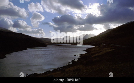 Sunrise over the lakes and mountains of Snowdonia National Park. - Stock Photo