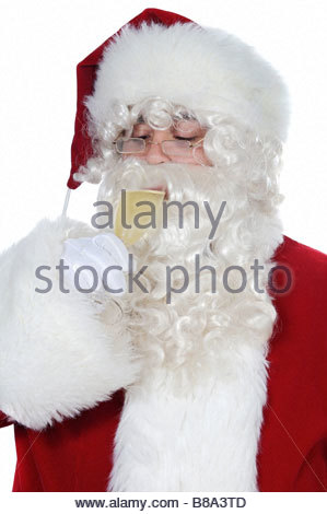 Santa Claus drinking a glass of champagne - Stock Photo