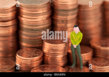 Model of woman standing on money - Stock Photo