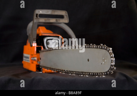 The blade and teeth of a woodcutters chain saw or power saw. - Stock Photo