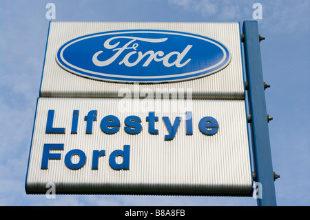 Ford Car Dealers Retailers Sign Against a Blue Sky 'lifestyle ford' - Stock Photo