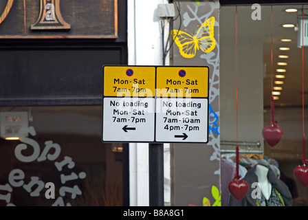 british yellow and white sign showing parking restrictions,  on chiswick high road, west london, england - Stock Photo
