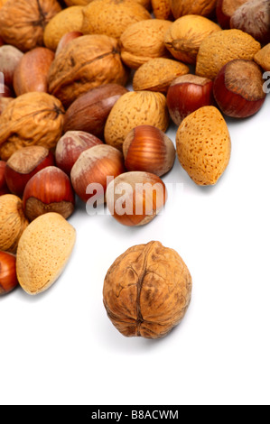 Scattered miscellaneous nuts on white background. Close-up - Stock Photo