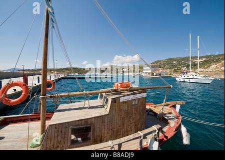 Boats in a marina on a greek island - Stock Photo