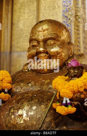 Laughing buddha in Wat Kalayanamit temple - Thonburi district in Bangkok, Thailand - Stock Photo