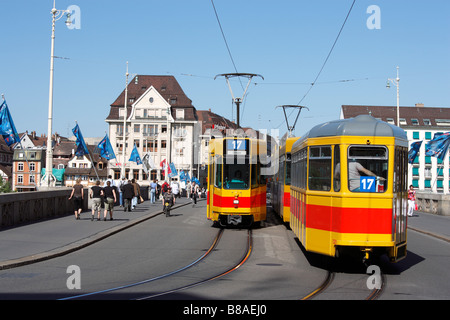 Trams passing Mittlere Rheinbrücke middle rhine bridge Little Basel Basel Canton Basel Stadt Switzerland - Stock Photo