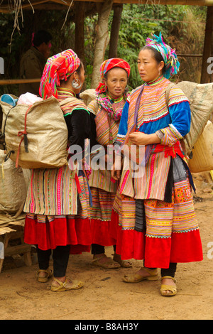 Flower Hmong women in traditional dress at Coc Ly weekly market, Sapa, Vietnam - Stock Photo