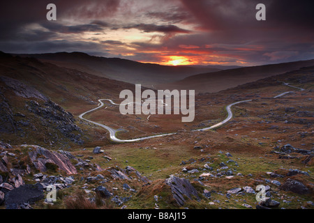 the road over the Healy Pass at dawn, Caha Mountains, Beara Peninsula, Co Cork, Ireland - Stock Photo