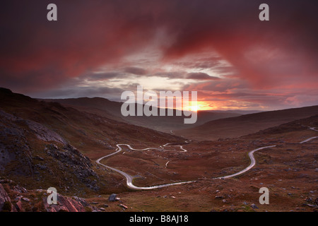 the road over the Healy Pass at dawn, Caha Mountains, Beara Peninsula, Co Cork, Ireland - Stock Photo