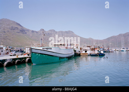 Fishing trawlers in Mariner's Wharf in Hout Bay in Cape Town in South Africa in Sub Saharan Africa. Resort Harbour Holiday Vacation Sea People Travel