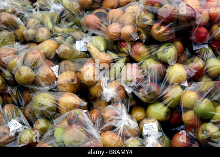 Bagged apples and pears on sale in Farmers Market, London - Stock Photo