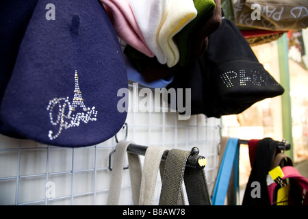 A collection of hats on a market stall in Paris. - Stock Photo