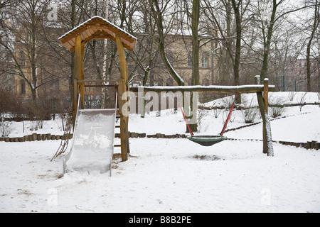 climbing frame in winter - Stock Photo