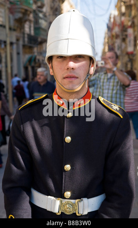 Malteese volunteer dressed in British colonial uniform to promote the Saluting Battery. Valletta, Malta. - Stock Photo