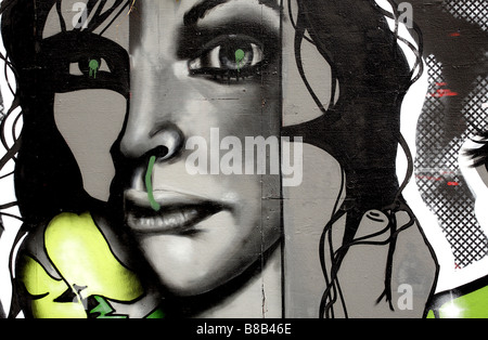 Landscape color image of Graffiti on the Berlin Wall in Germany. - Stock Photo