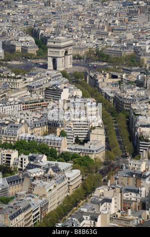 An elevated view looking over Paris towards the Arc de Triomphe taken from the Eiffel Tower on a sunny spring day - Stock Photo