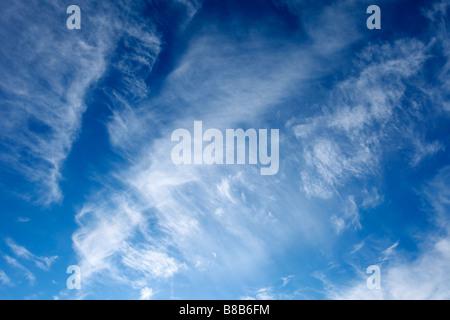 Blue sky with white wispy clouds - Stock Photo