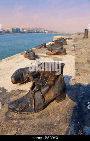 Jewish memorial shoes on the Danube bank , Budapest , Hungary . - Stock Photo