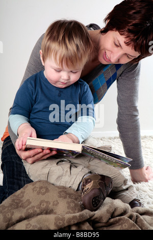 Baby boy and mother reading (with signed model release - available for commercial use) - Stock Photo