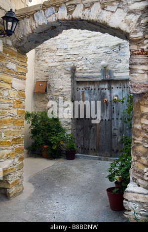 Old house archway entrance and wooden door in Upper Lefkara, South Cyprus. - Stock Photo