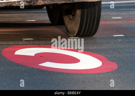 Congestion charge sign on road London England UK - Stock Photo