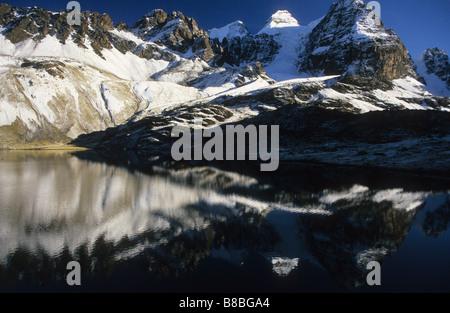 Mt Condoriri reflected in Lake Chiar Kota, Cordillera Real, Bolivia - Stock Photo