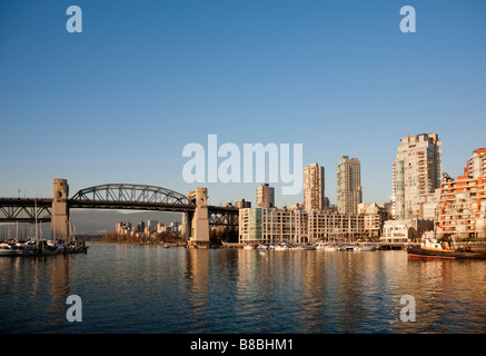 Burrard Street Bridge and the downtown skyline along False Creek, Vancouver, Brittish Columbia, Canada - Stock Photo
