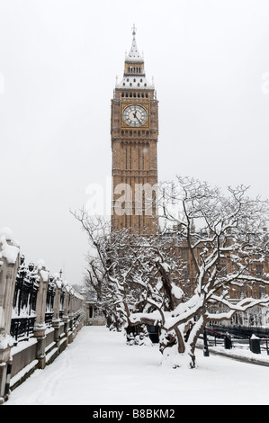 Big Ben and Palace of Westminster in the snow London England UK - Stock Photo