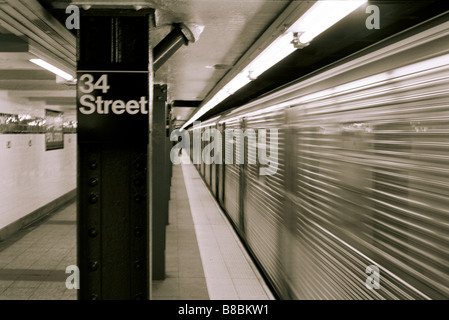 34th Street Subway Platform, New York City - Stock Photo