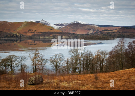 A winter view across Derwentwater with reflections of the Derwent Fells in the ice covered water of the lakenear - Stock Photo