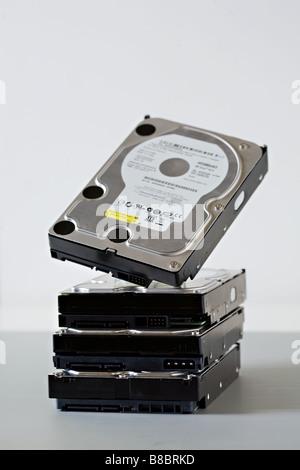 a stack of sata computer hard disk drives - Stock Photo
