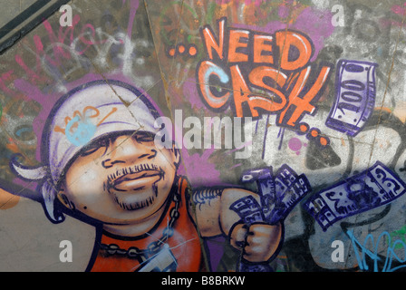 Need Cash: Graffiti of young man throwing around money, Royal Festival Hall skateboard park, South Bank, London - Stock Photo