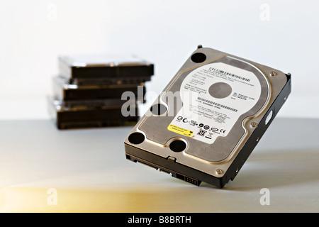 multiple stack of sata computer hard disk drives - Stock Photo