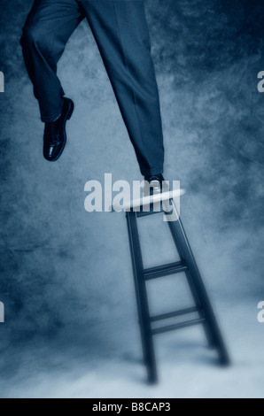 FL6152, Trevor Bonderud; Businessman Balancing Stool - Stock Photo