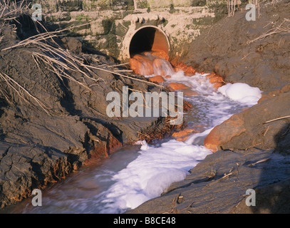 River pollution from outfall - Stock Photo